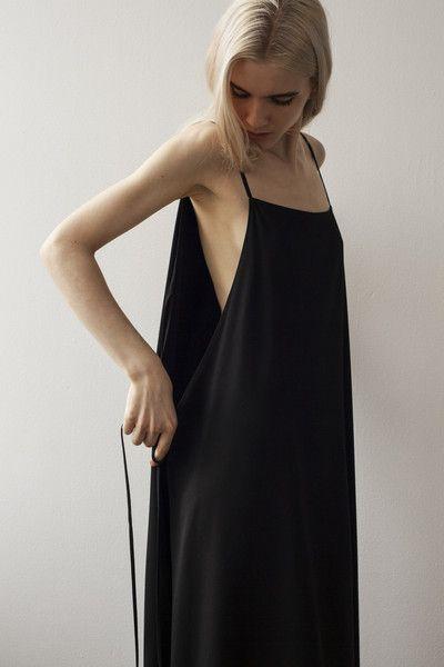 Minimal black apron dress, contemporary fashion details // Shaina Mote