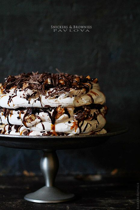 SNICKERS & BROWNIE PAVLOVA  Ingredients:  6 oz eggs whites (about 5-6 large eggs)  1 1/4 cup granulated sugar  1/4 powdered sugar  1 teaspoon vanilla  1 teaspoon distilled white vinegar  pinch of salt  6 oz brownies, crum  6 oz Snickers, chopped  2 cups whipped cream (recipe follows)  WHIPPED CREAM  1  cup heavy cream  1/4 cup confectioner sugar
