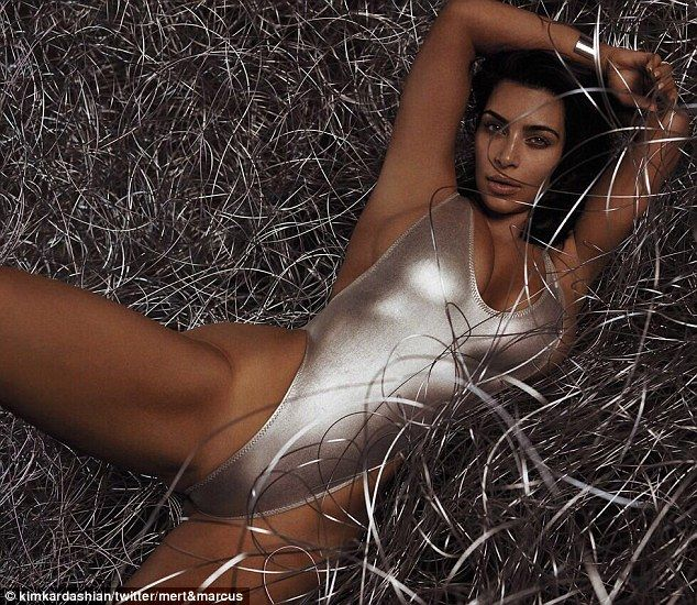 Racy: Kim Kardashian wore a high-cut silver swimsuit for a racy new photoshoot by famed photographers Mert Alas & Marcus Piggott