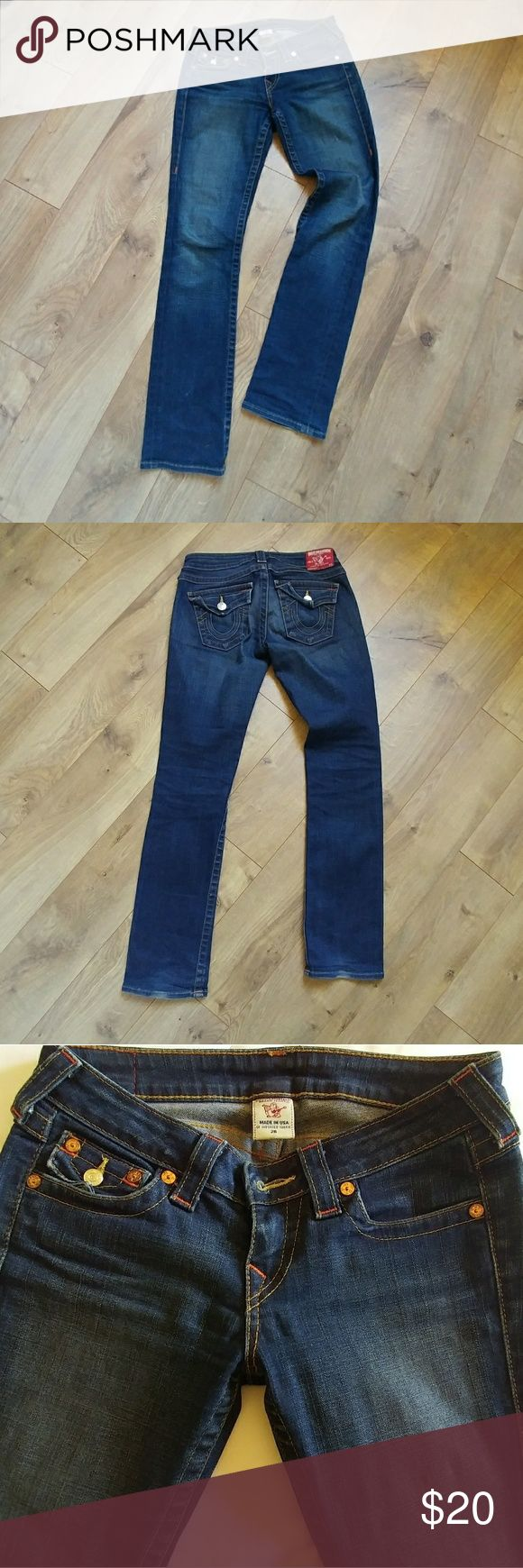 """Dark Wash True Religion jeans 5 pocket, straight leg, dark wash jeans.  With copper color stitching, & copper button detail in the front. Signature back pockets with silver buttons. Imported fabric. Great condition. Great fit! 99% cotton, 1% elastine. Inseam: 31"""" outside seam: 39"""" rise: 7 1/2""""  🌟The 3rd pic is what the real color looks like🌟. 💲Offers welcome!! True Religion Jeans Straight Leg"""