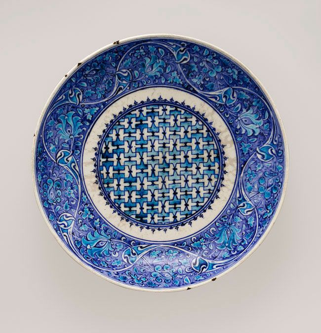 Iznik Dish, Turkey, mid-16th century. Stonepaste; painted in turquoise and two hues of blue under transparent glaze