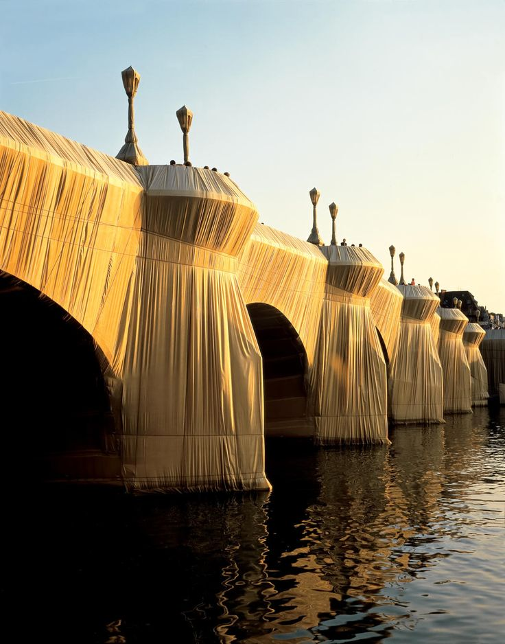 "Christo and Jeanne-Claude, ""The Pont Neuf Wrapped,"" 1975-85. 454,178 sq.ft. of Golden Sandstone-Colored Woven Polyamide Fabric and Terra Cotta-Colored Polypropylene Rope. Paris, France, September 16 - October 5, 1985."