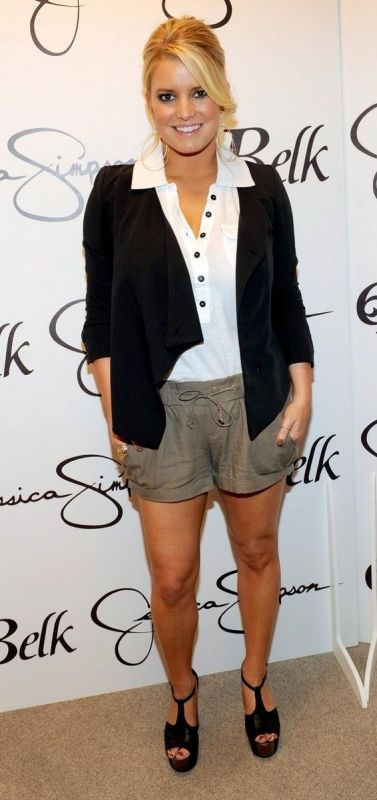 Jessica Simpson wearing Jessica Simpson Gold Leaf Two Finger Ring in Worn Gold Jessica Simpson Dany Platform in Black Leather Jessica Simpson Isabel Ponte Knit Jacket in Black Jessica Simpson Mirage Tie Front Short
