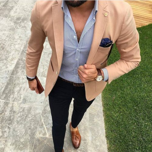 Consider pairing a tan blazer jacket with black chino pants to achieve a dressy but not too dressy look. Show your sartorial prowess with a pair of brown leather tassel loafers. Shop this look on Lookastic: https://lookastic.com/men/looks/blazer-dress-shirt-chinos/24055 — White and Navy Polka Dot Dress Shirt — Navy Paisley Pocket Square — Black Sunglasses — Tan Blazer — Dark Brown Leather Watch — Dark Brown Leather Belt — Dark Brown Bracelet — Black Chinos — Brown Leather Tassel ...