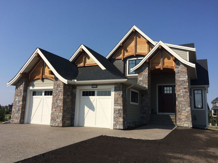 Tapered rock and stunning cedar detailing in open gables in this Craftsman home #craftsman #cedar #tapered rock #coopersairdrie