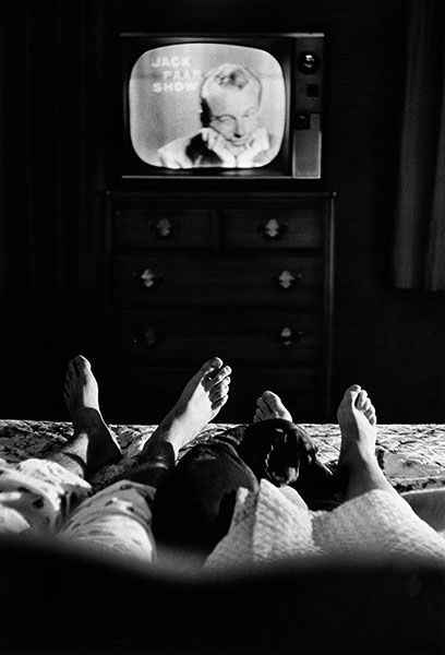 Cornell Capa  - Bronxville, New York, 1959... Jack Paar watching himself on television in a show taped earlier in the day with his wife at home.