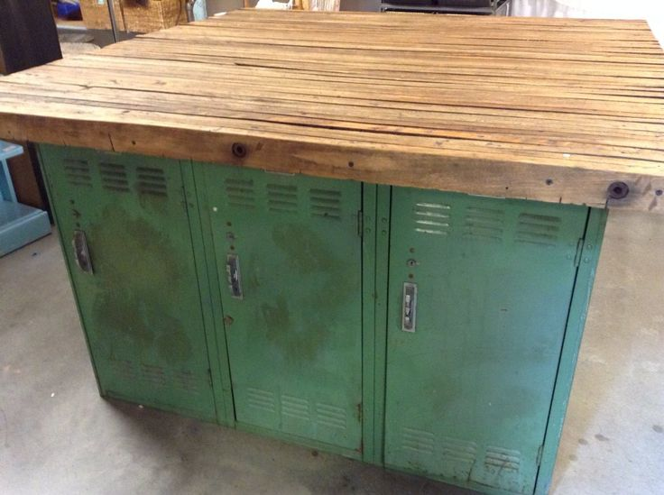 This awesome butcher block table from six repurposed lockers is 54 inches square. The butcher block top is 2 inches thick. $795.00 USD  Room 143