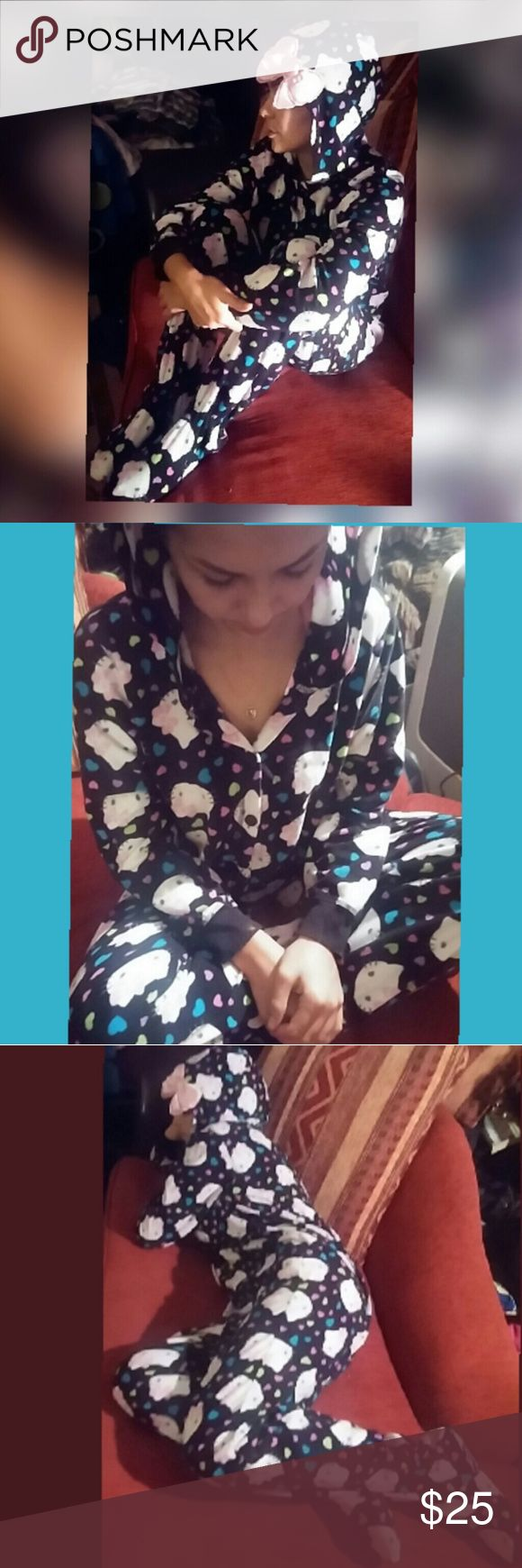 Hello kitty onesy Ladies hello kitty hooded onesy.. has a cute bow on the hoody..button down front..with footys..so soft & keeps u nice & warm on the colder nites 2 come..literally from ur head 2 ur toes! Excellent condition! Intimates & Sleepwear