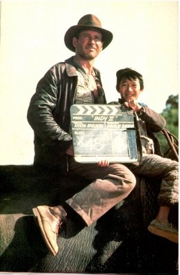 Harrison Ford and Jonathan Ke Quan on the set of Indiana Jones and the Temple of Doom.
