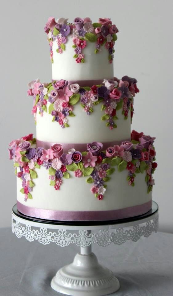 Flower laden 3-tiered wedding cake