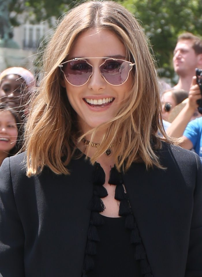 0fad4089b9 Olivia Palermo wearing a black tassel jacket and Dior