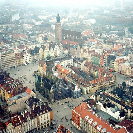 Wroclaw, Poland - the gorgeous town square. Was there just last year, and I miss it already... http://wroclaw.awesomepoland.com/ #wroclaw #poland