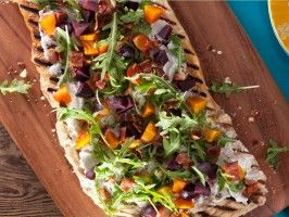 Beet, Bacon and Herbed Goat Cheese Flatbread. I made this for dinner tonight. It was PHENOMENAL.  I sauteed the stems and leaves from the beets with some radicchio and lemon juice as a side.