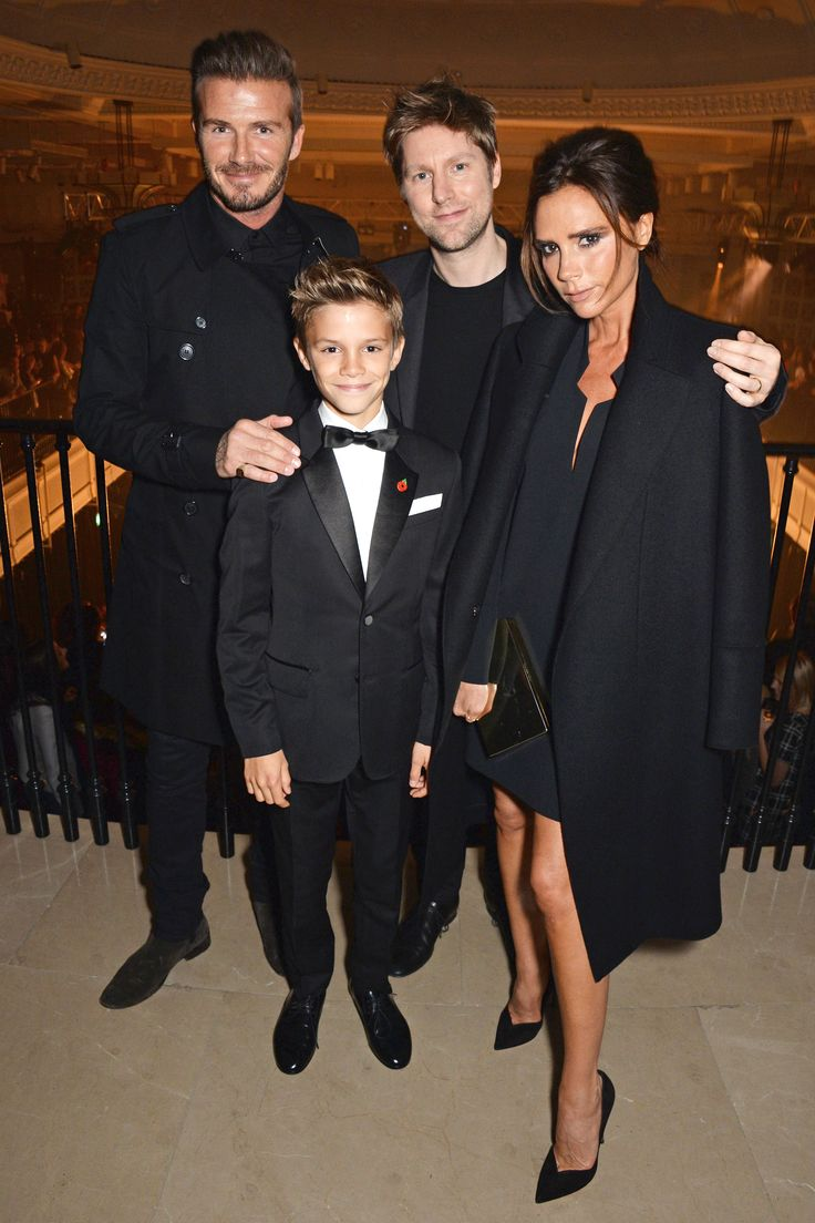 David Beckham, Romeo Beckham, Christopher Bailey, and Victoria Beckham attend the launch of the Burberry festive campaign on Nov. 3, 2014, in London.    - Cosmopolitan.com