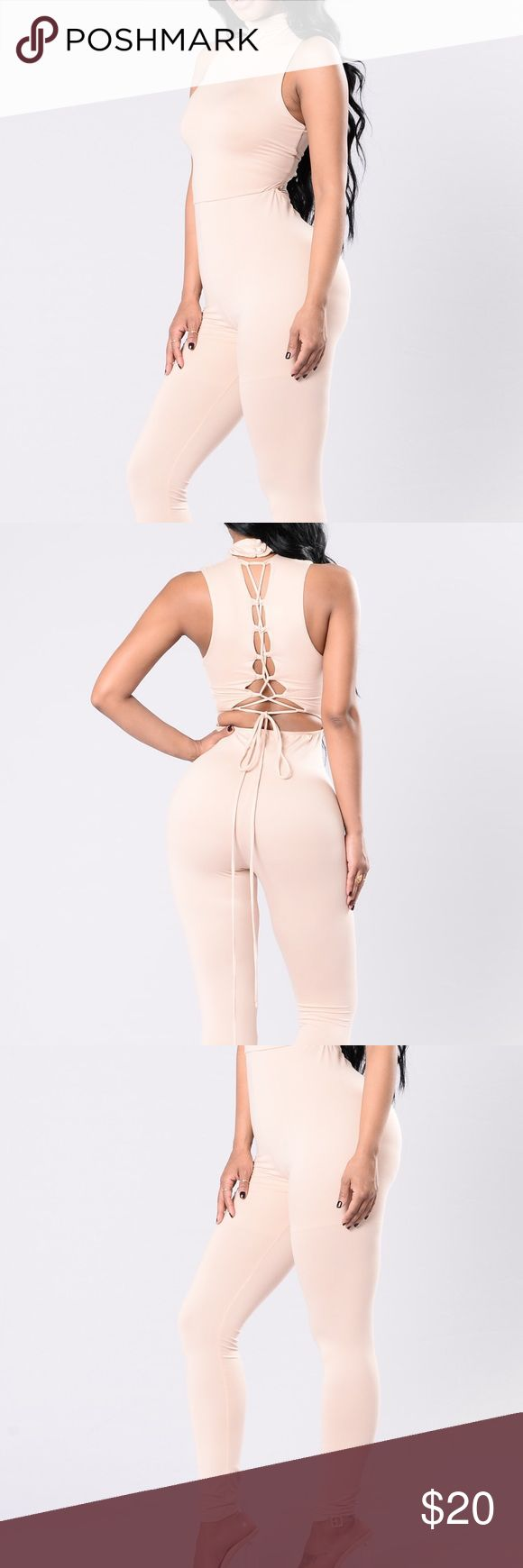 Nude jumpsuit Never worn. Tie detail in the back, size large. Fashion Nova Pants Jumpsuits & Rompers