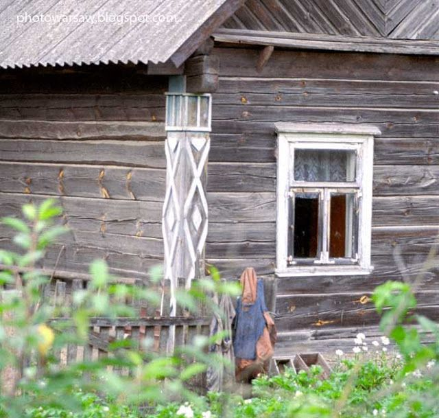 Old and lovely farmahouse in Belarus. It's so imaginative that on most of these houses are carved motives of cards: clubs, diamonds, hearts, spades.