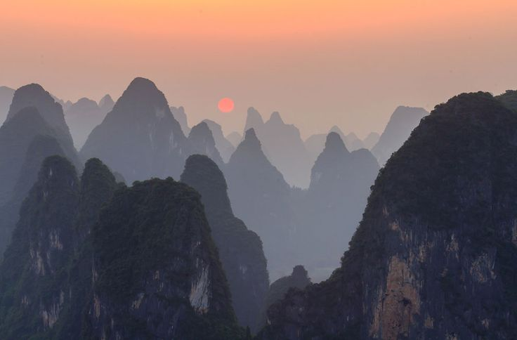 Sunset on top of Lao Zhai mountain at the bank of Li River, Xingping, Guangxi, China. Source: http://www.theatlantic.com/infocus/2013/05/2013-national-geographic-traveler-photo-contest/100516/