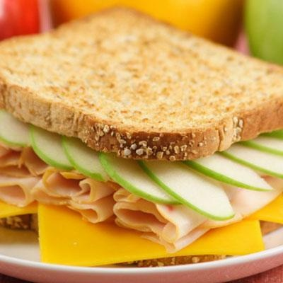 TURKEY-APPLE MELT SANDWICH  Layer 2 teaspoons honey mustard, 2 slices deli turkey breast, apple slices, and 1 ounce thinly sliced Gruyère or aged Cheddar cheese on whole-wheat bread. Toast in a skillet coated with cooking spray on medium heat until bread is lightly browned on both sides.