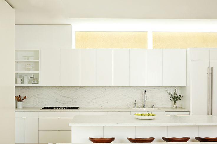 mixing the whites, white kitchen, stone backsplash, marble counters