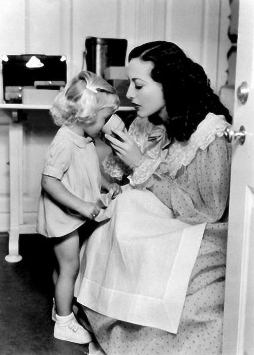 Joan Crawford on the set of 'Gorgeous Hussy' with niece Joan LeSueur. 1936.