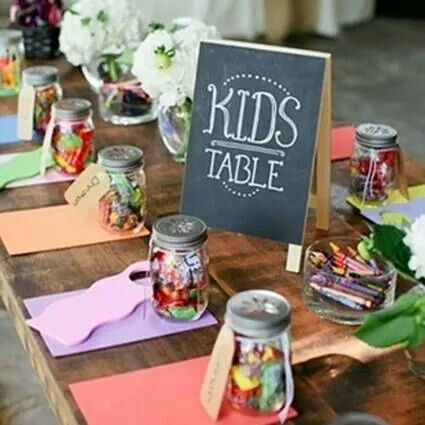 Kids table with candy, crayons, games and what not for the wedding reception