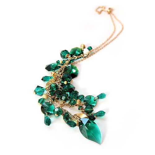 Emerald shining Swarovski crystals and gilded silver. Diuu