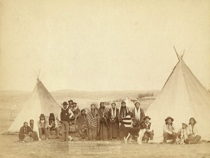 The           Indian Girl's Home. A group of Indian girls and Indian police at Big Foot's           village on reservation 1890. Photo: Grabill, John C. H.