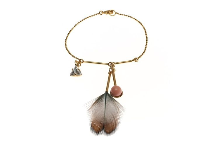 Light like a summer breeze and with an easy hippie-esque touch this pearl and stick chain bracelet is the perfect companion for summer. Wear it alone or combine it with other feather pieces available in this collection to create an individual look.  COLOR Gold, Crystal, Pink MATERIAL Brass 23CT gold plated, Swarovski Crystals, Swarovski Crystal Pearls, Feathers SIZES Please find the detailed size chart below  All our products are entirely manufactured in Germany, with every single piec...