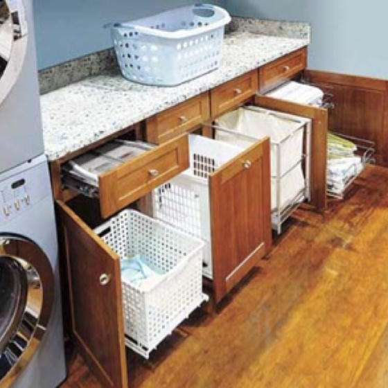 I love how the laundry baskets are in cabinets!