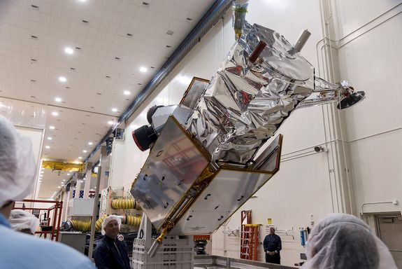 DigitalGlobe's WorldView-4 spacecraft undergoes inspection by engineers at Lockheed Martin before being sent to Vandenberg Air Force Base in California.