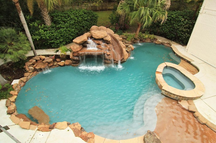 Stately brick traditional w/beautifully-proportioned rooms & elegant finishes throughout. Pool with spa and rock waterfall.
