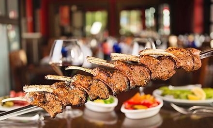 Churrascaria servers carve slow-roasted meats from skewers onto plates; a sprawling salad area showcases more than 50 gourmet sides