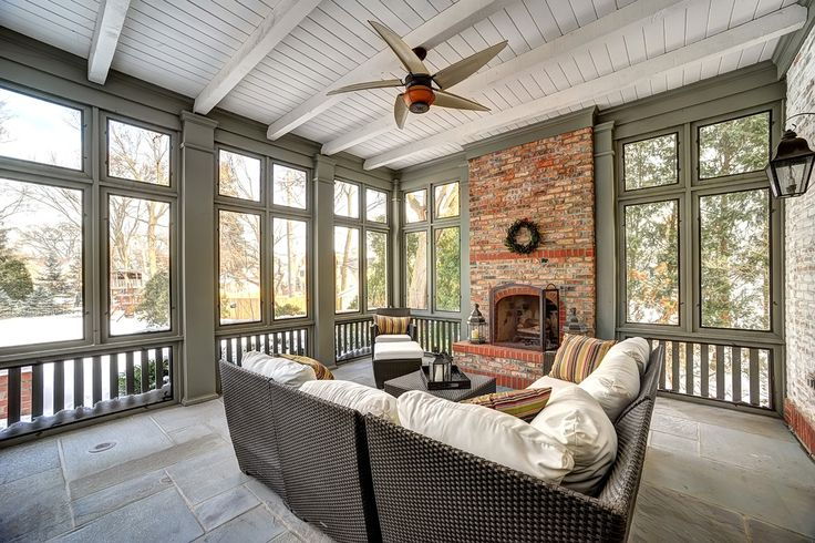 Lovely Porch With Vaulted Ceiling And Brick Fireplace