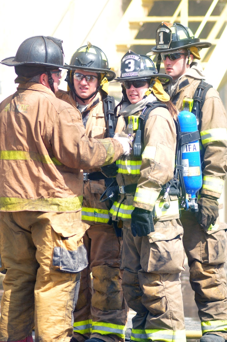 IFA Firefighters Jack Haney, Cate Hazenstab and Sam Phoebus explain the findings of a 360 to Fire Suppression Instructor Bill Hutchison.