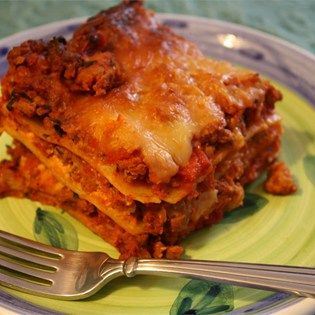 "American Lasagna I ""ow!! Wonderful flavor! Be sure and simmer the sauce the maximum amount of time. Making the lasagna a day ahead and refrigerating is definitely key to having outstanding flavor!"""