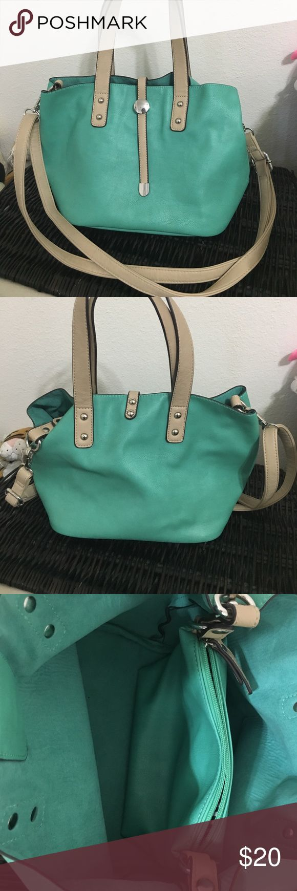 Charming Charlie aquamarine 2 in 1 handbag With this bag you get two bags for the price of one!! Beautiful bright color!! Small pouch that can be used as a crossbody for on the go. Or keep it inside for extra controlled storage for smaller items. Bags Crossbody Bags