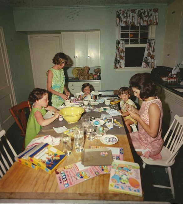 jackie kennedy coloring eggs with her son john her daughter caroline and family friend sally