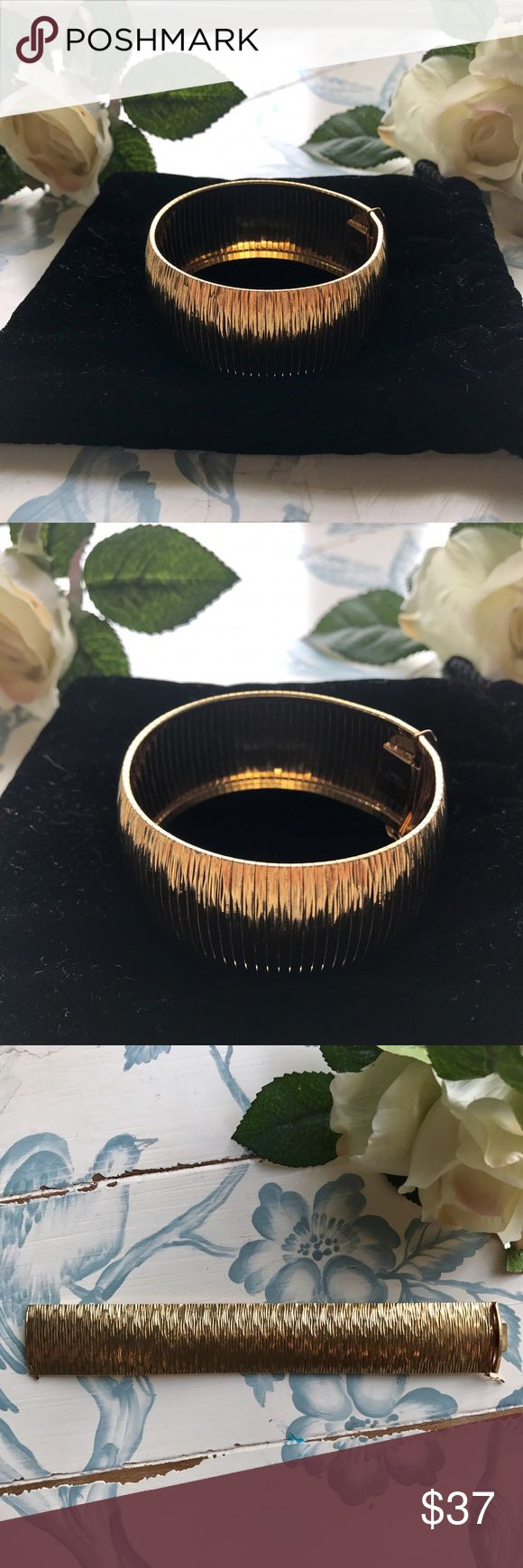 Dyadema Bronze Gold Plated Cuff This Bronze Gold Plated Cuff made in Italy by Dyadema would be a great statement piece for any outfit. The bracelet is flexible with a push pull closure and safety latch. It's only been worn twice and is 7.5 inches long. Dyadema Jewelry Bracelets