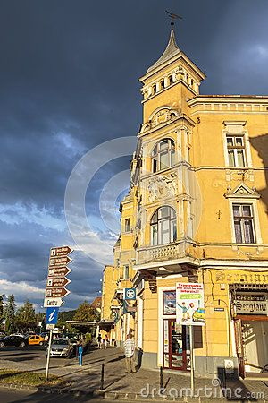 Old historic building lit by the sunset light on overcast day on July 16, 2012 in Brasov, Romania. Brasov is the 7th largest city and the most visited in Romania.
