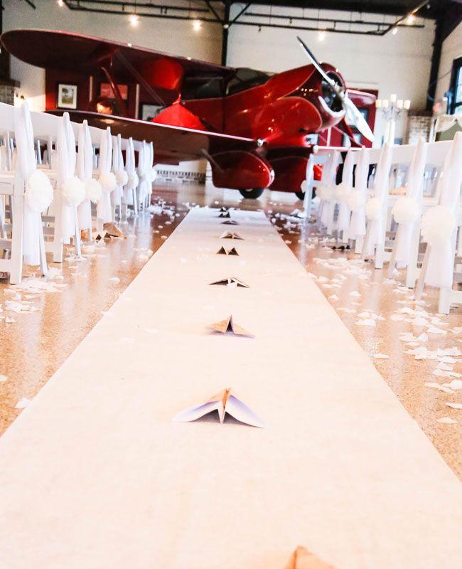 A Paper Airplane Lined Aisle | Blue Dahlia Photography | Blog.TheKnot.com