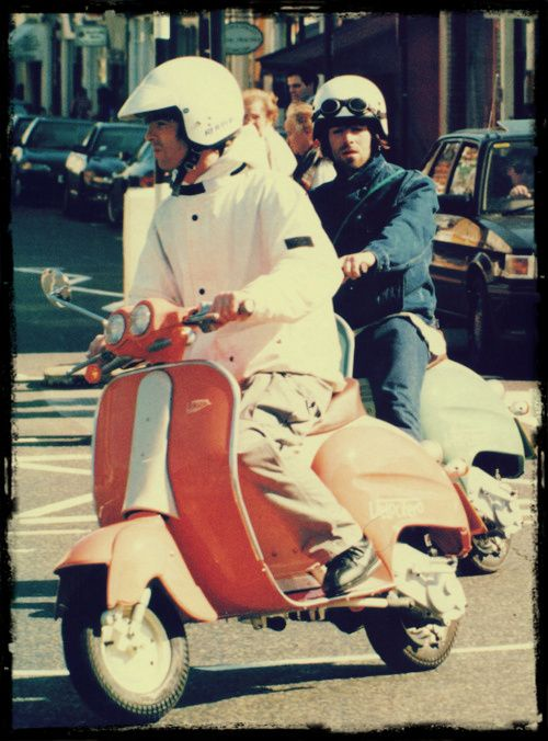 Noel and Liam Gallagher and Vespa