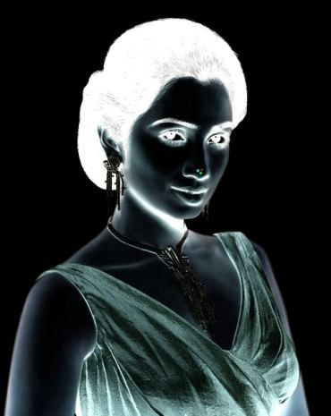 1) Stare at the red star on the girl's nose for 30 seconds. 2) Turn your eyes towards the wall/roof or somewhere else on a plane surface. 3) Keep blinking your eyes!