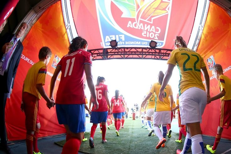 Costa Rica and Brazil players enter the field