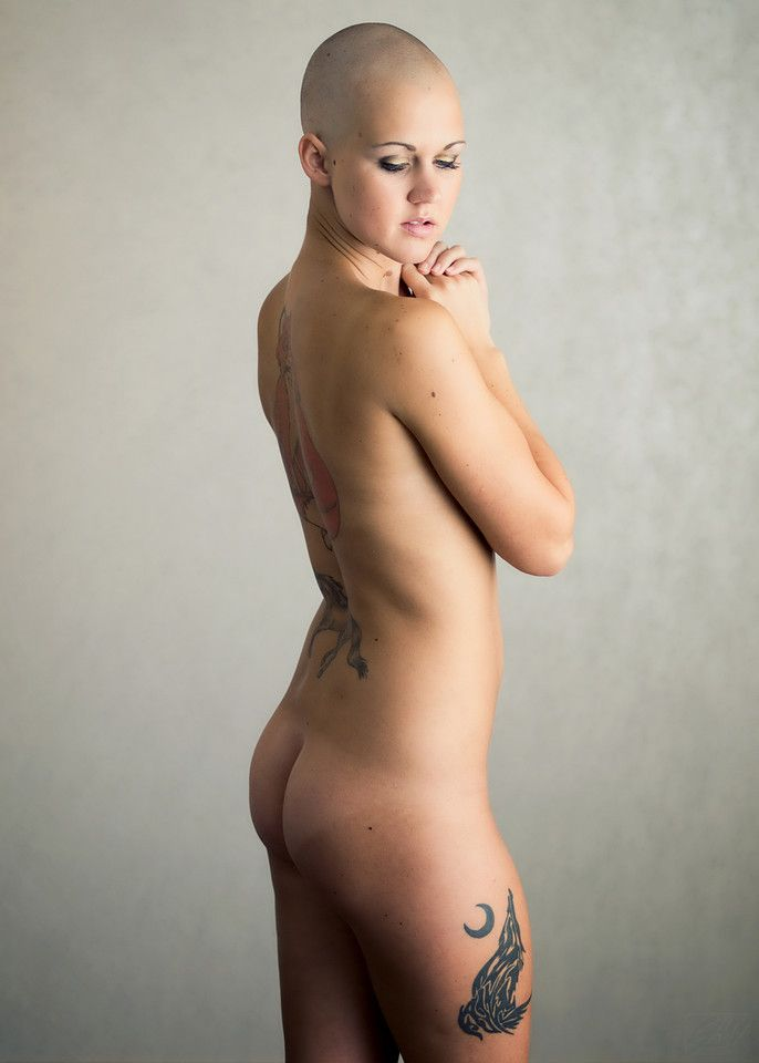 Nude with shaved head