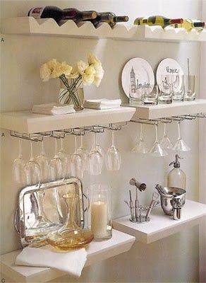 Floating shelves on a bit of additional kitchen wall space, where there is no room for extra cabinet space.