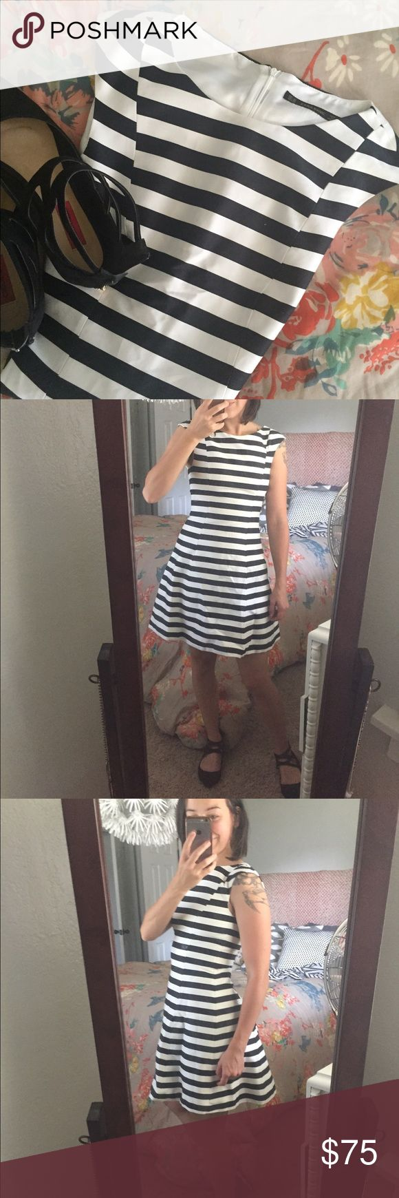 Zara Basic Striped Cocktail Dress Navy and white striped cocktail dress with cap sleeves. I'm not sure what type of fabric this is. It feels like a silk blend. I fell in love with dress because of the fit but unfortunately it's too small for me as I wear a small and this an xs. Zara Dresses