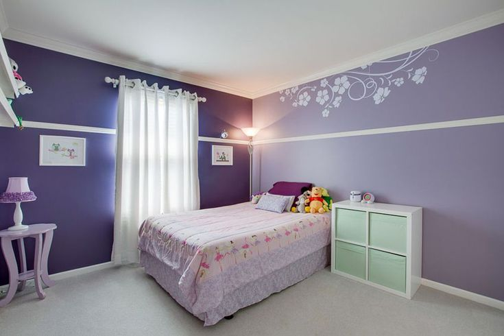 Light purple and dark purple color girls bedroom with flower wall stencil