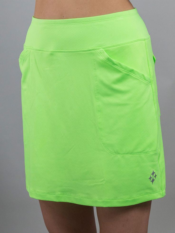 Long Tennis skort with pockets! l Textured Jacquard knit offers forgiving coverage that comfortably skims, never hugs, your midsection. Wicking properties eliminate moisture retention keeping you dry while anti-pilling and antimicrobial protection enhance fabric durability.