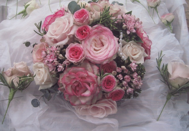 Pink roses, bouvardia, spray roses, rosemary, and pearls