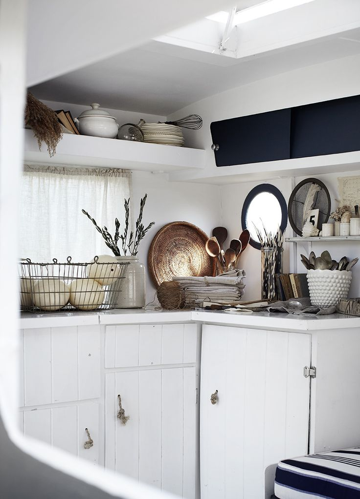 Inside Frankie the caravan: fresh white interior with nautical touches and beautiful vintage homewares ready for the markets. Styled by ©Kara Rosenlund